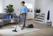 Rug cleaning by a woman